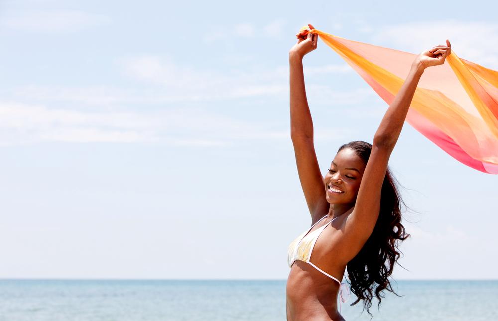 Woman enjoying herself in a beach.