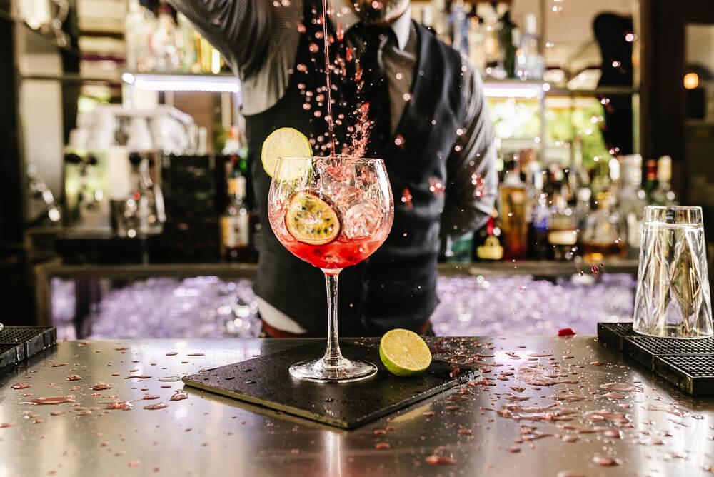 Expert barman making cocktail