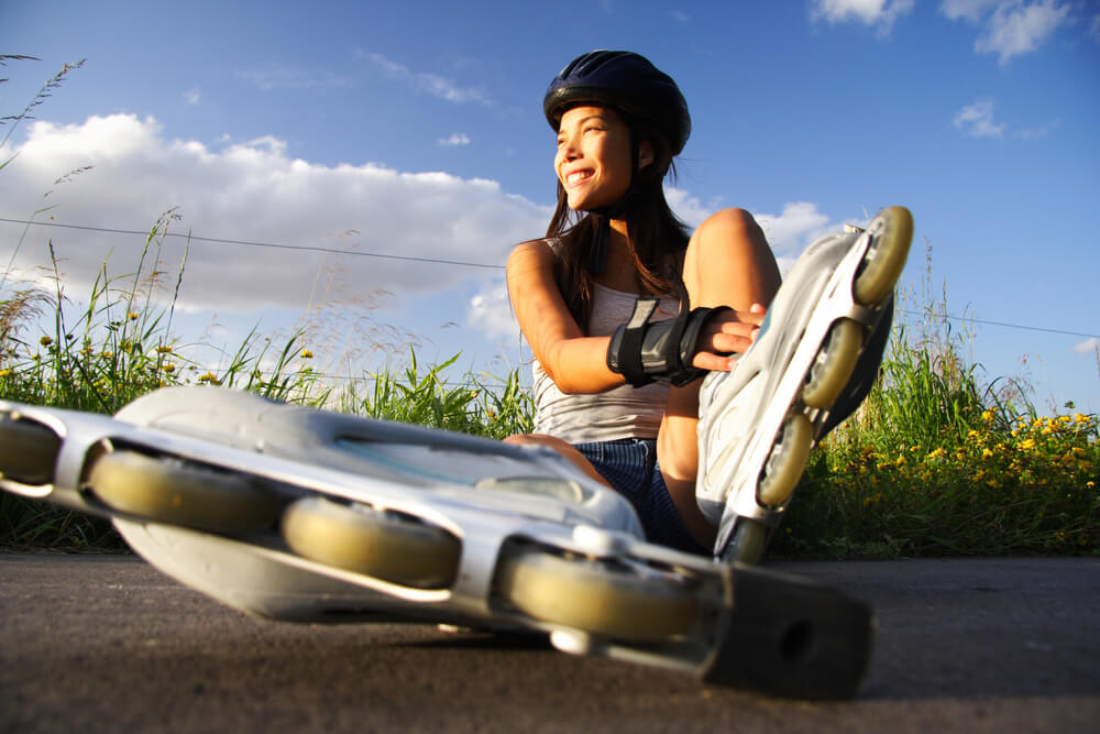 woman wearing protective gear for roller skating