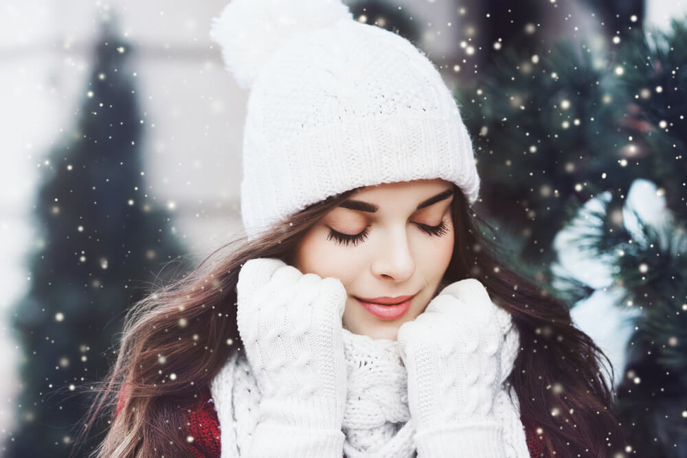 Woman with beautiful skin outdoors in winter