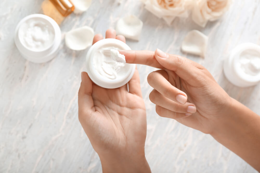 Hands in skin cream
