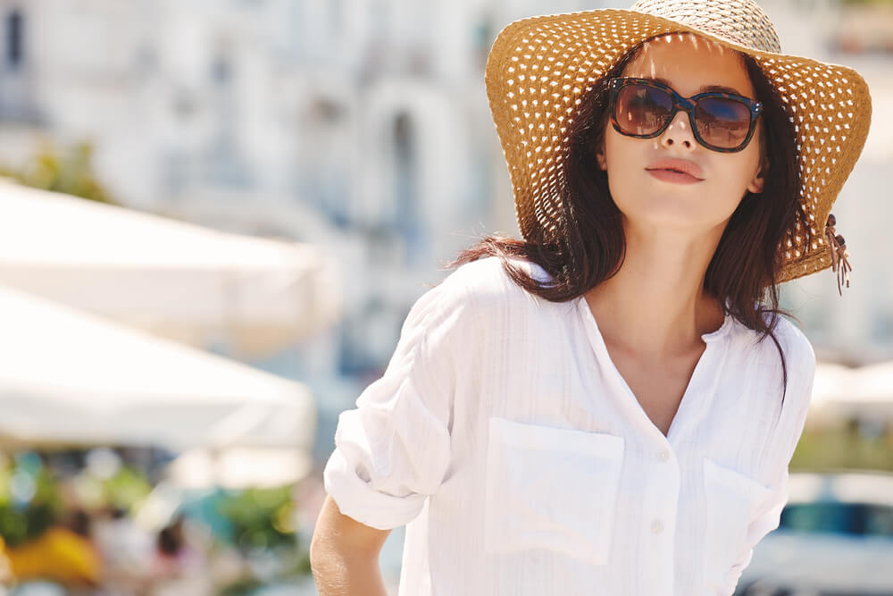 Woman wearing sunhat and sunglasses