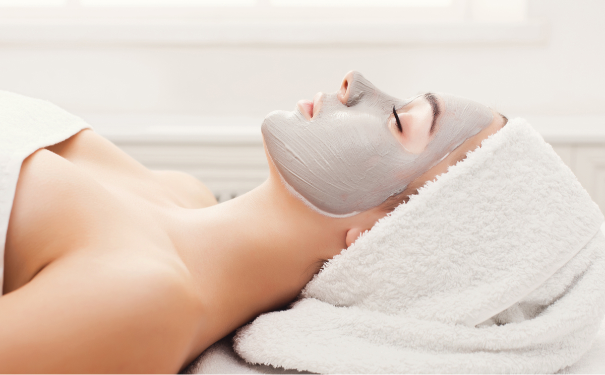 Woman lying down with face mask on