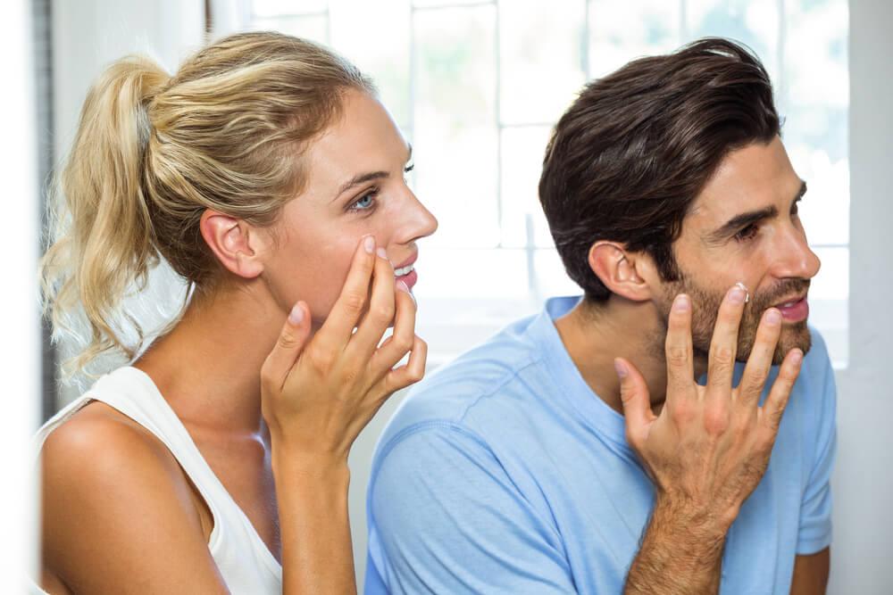 Couple using face cream