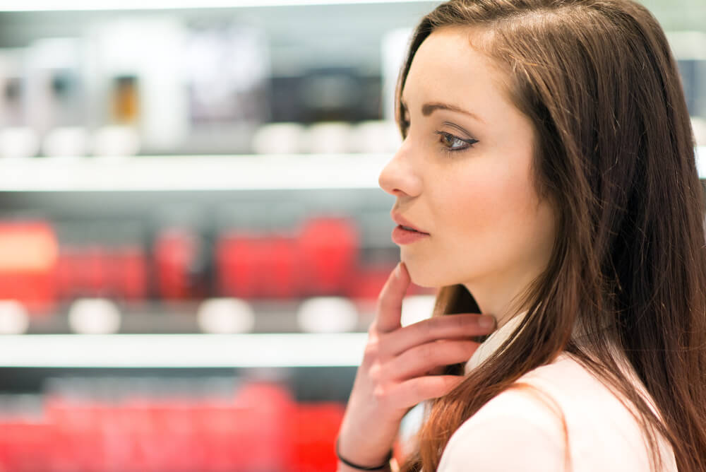 Woman choosing skincare in shop