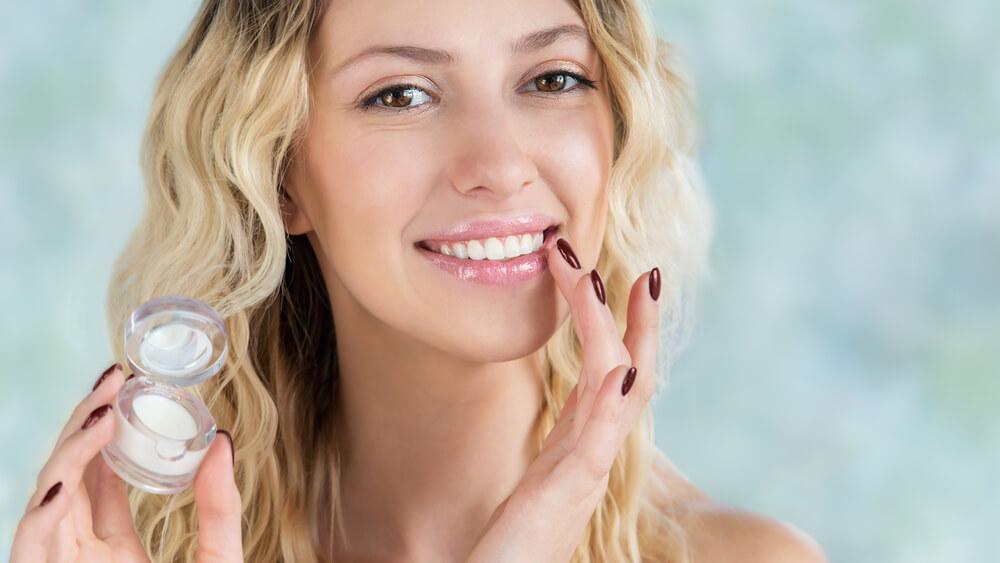Woman applying lip primer