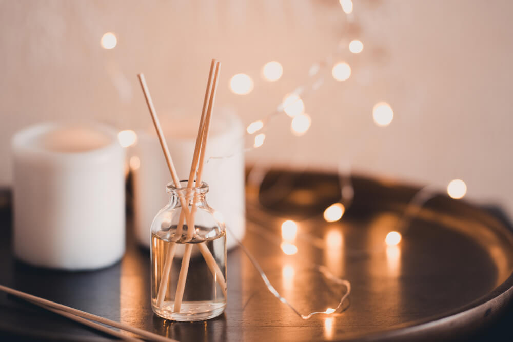 Candles and reed diffuser on table