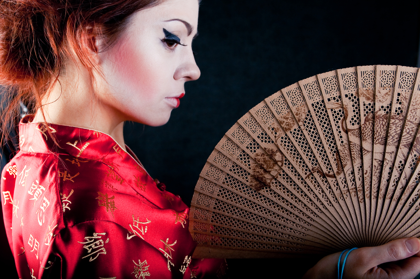 portrait of beautiful japanese geisha woman with fan