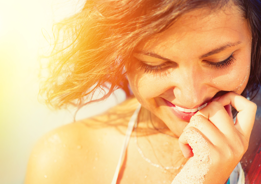 Woman smiling in a beach.
