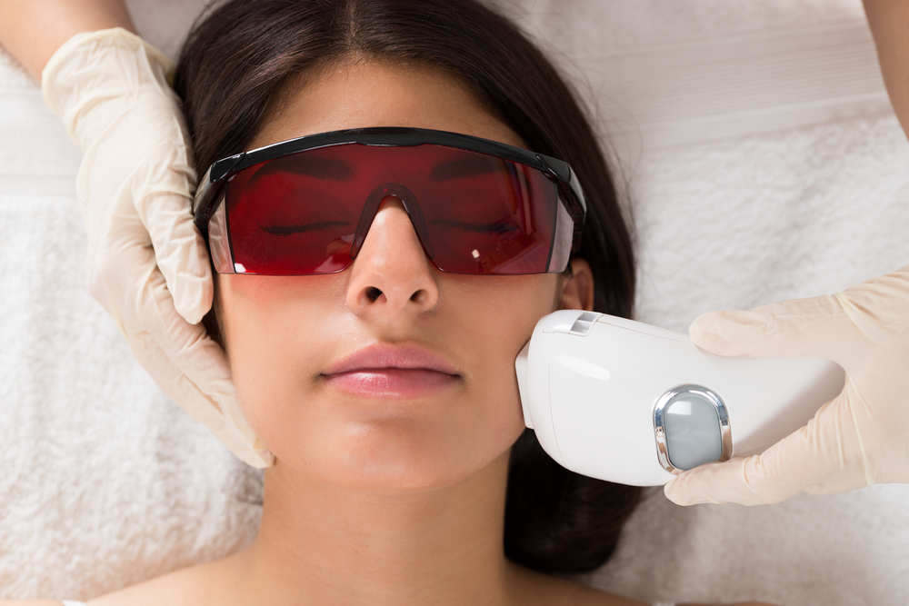 Woman getting laser therapy