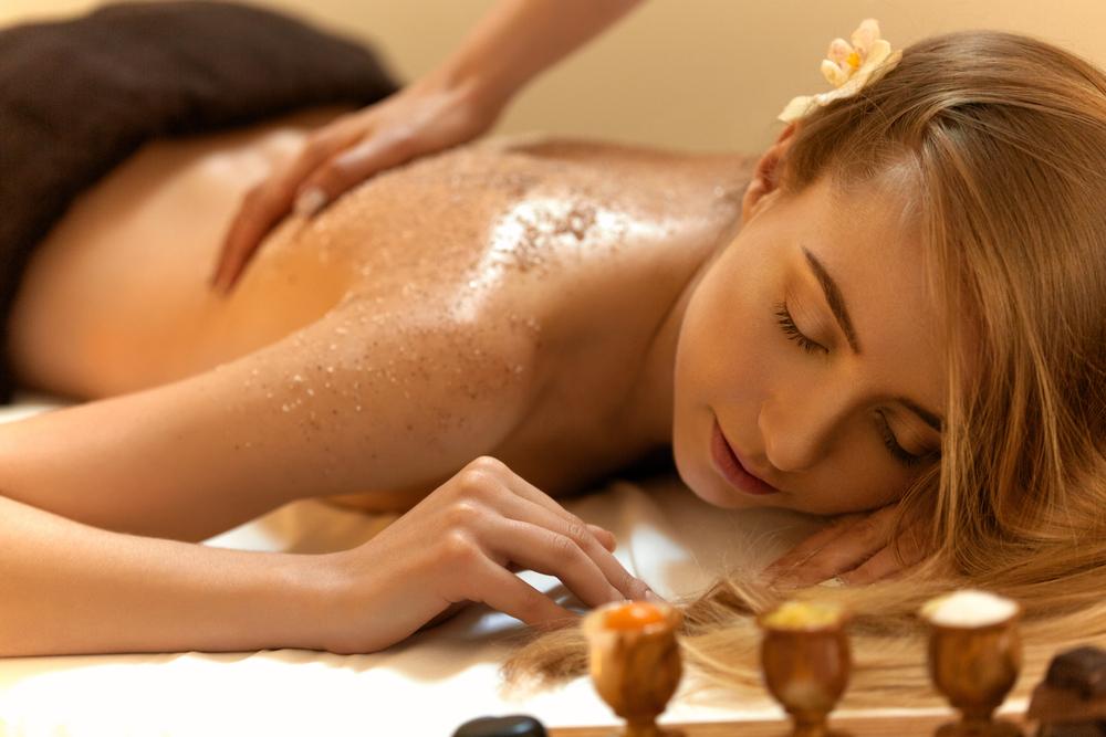 Woman enjoying a body scrub.