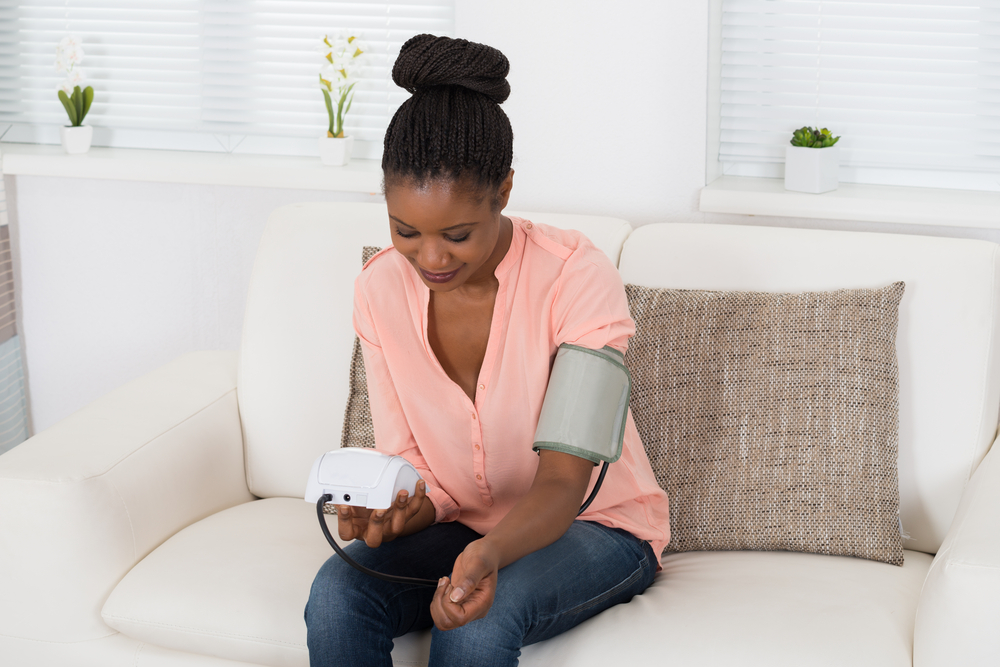 Woman monitoring blood pressure