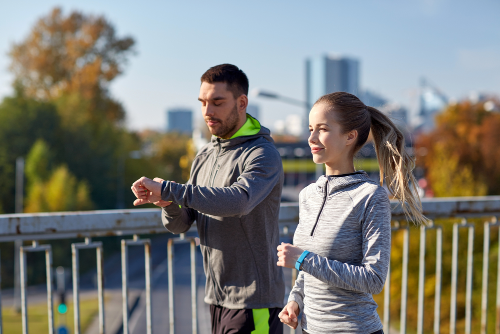 Runners with fitness trackers
