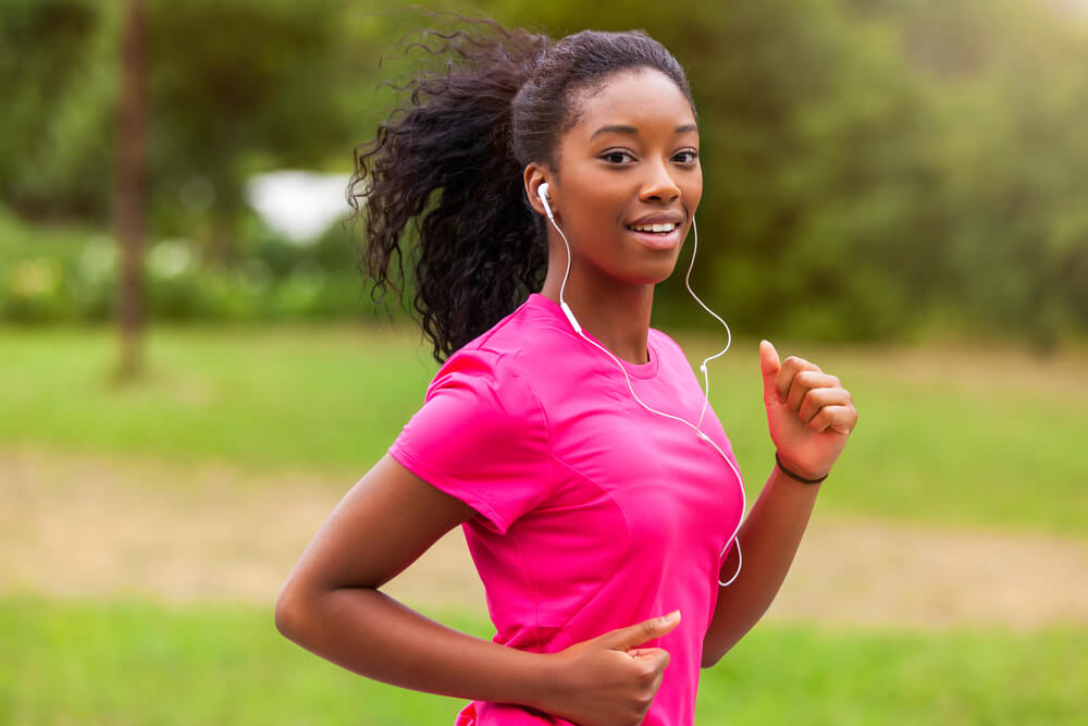Woman in pink jogging in the park