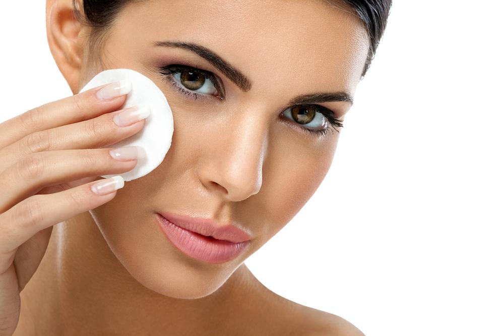 Woman removing makeup.