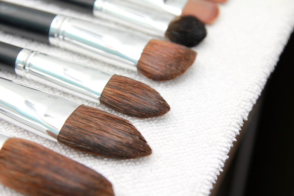 Makeup brushes on a towel after washing.