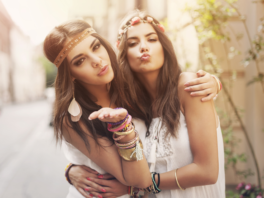 Two friends dressed for a music festival in a boho look.