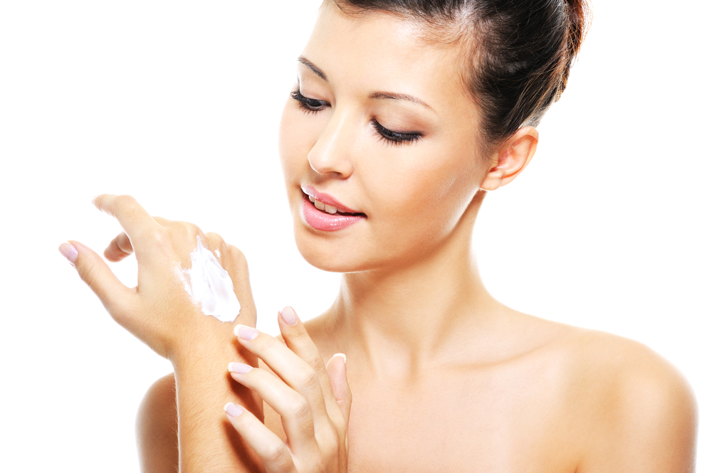 Woman applying a moisturizer.