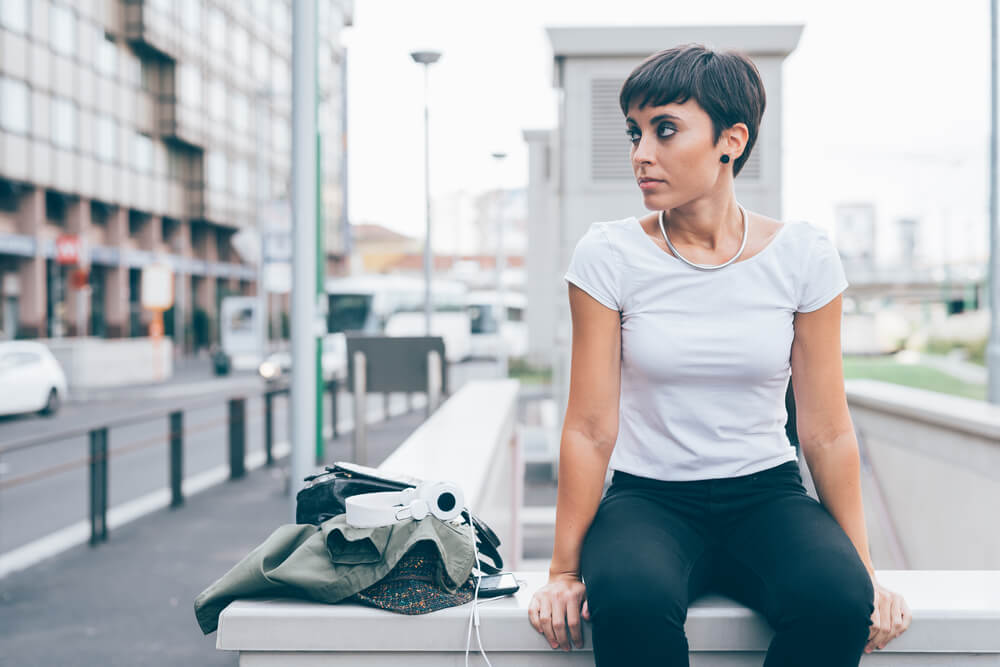 Sitting woman with pixie cut hairstyle