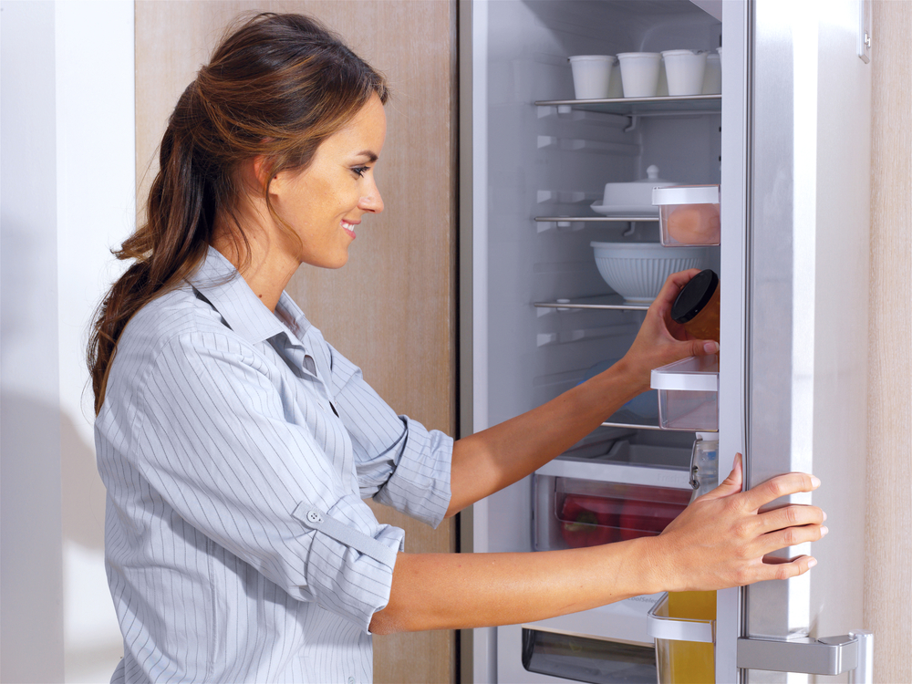Woman taking out stuff from the fridge