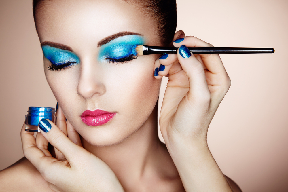 Woman with blue eye shadow