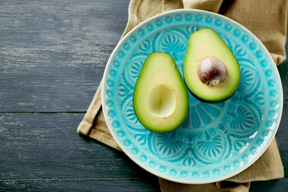 Sliced avocado on a blue plate