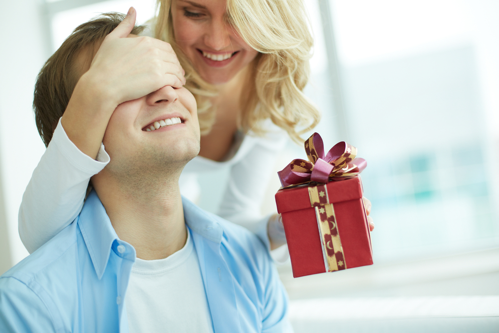Woman surprises man with present