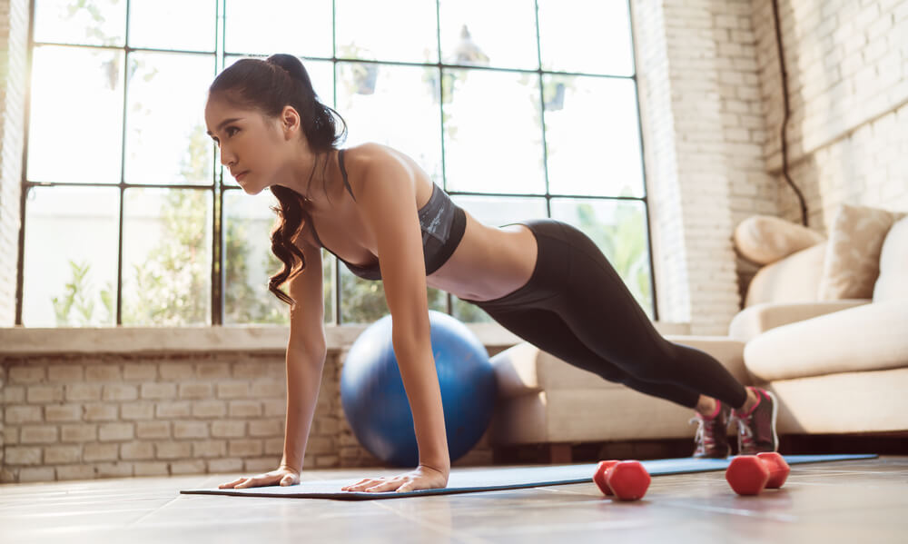 Woman doing push up at home