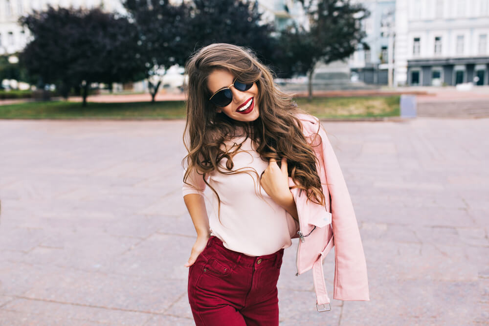 Happy woman dressed in pink and with shades