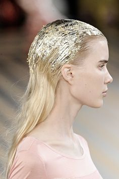 Gold foil hair on the runway