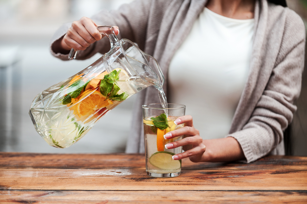 Woman having detox water