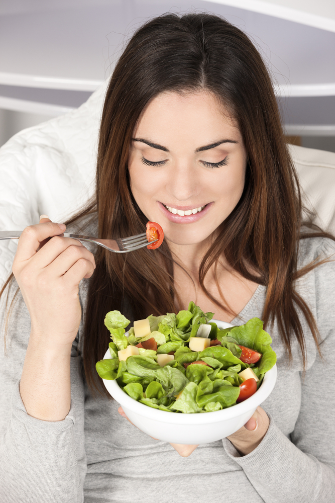 Woman eating healthy food.