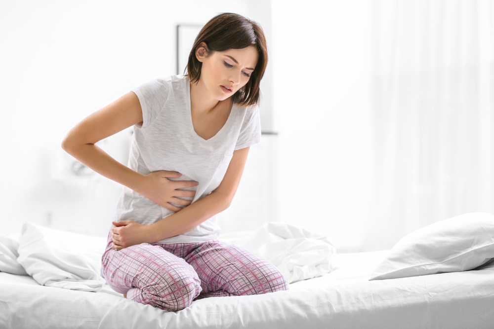 Woman clutching stomach