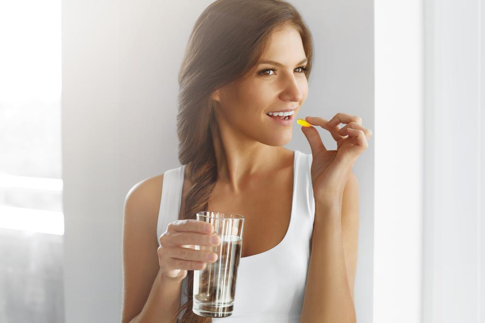 Woman having vitamins