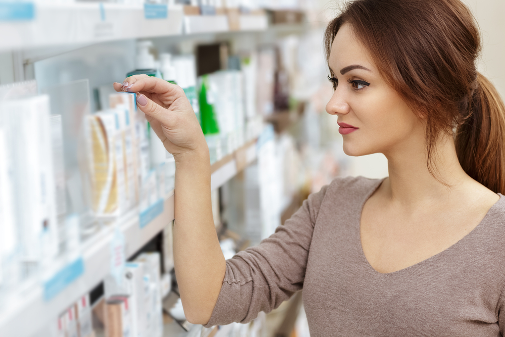 Woman looking at product label