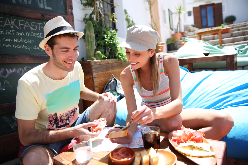 Couple eating local food while traveling
