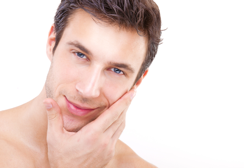 Attractive man caring for his skin