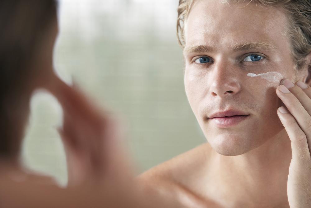 Man applying skincare product