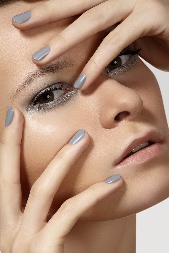 Woman with gray nail polish