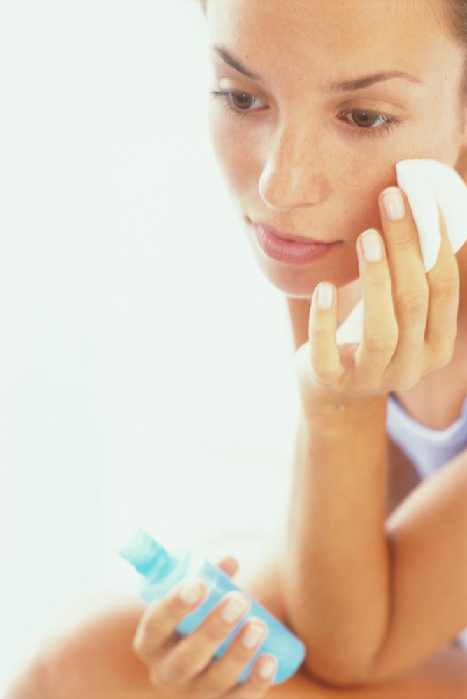 Woman cleansing skin.