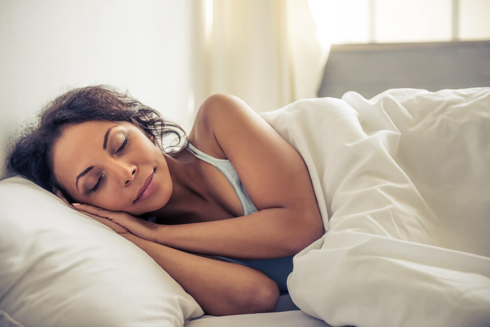 Woman having a nice sleep on bed