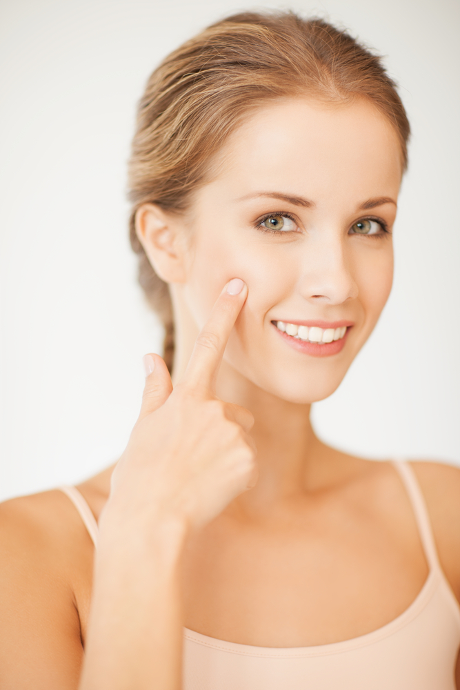 Woman pointing at her cheeks
