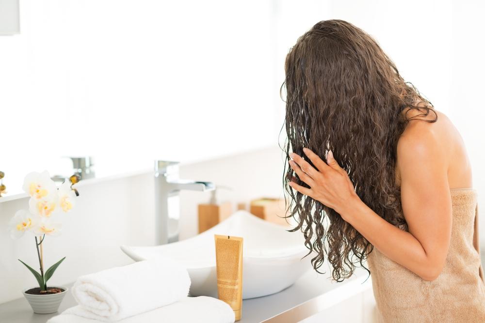 Woman drying her hair.
