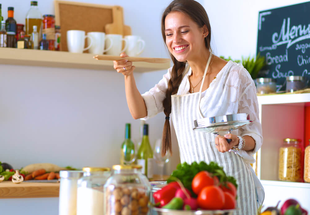 Happy woman cooking a healthy meal