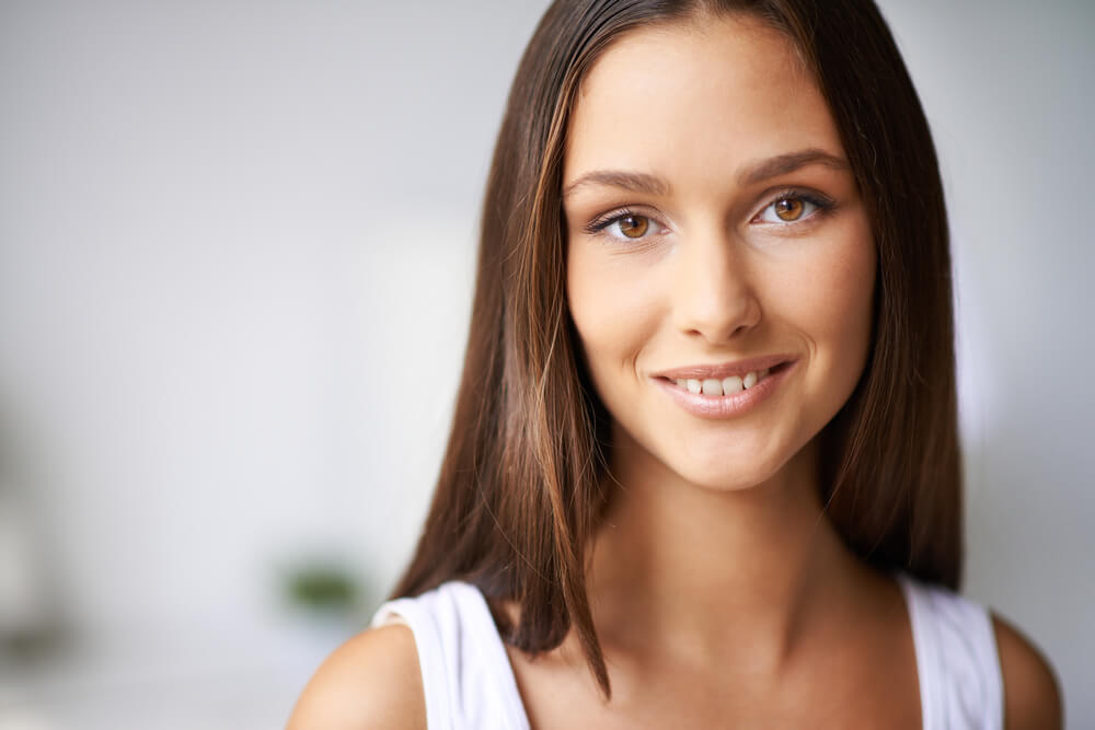 Close up of smiling woman with long hair