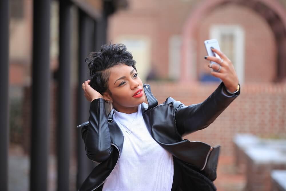 A stylish woman taking a selfie