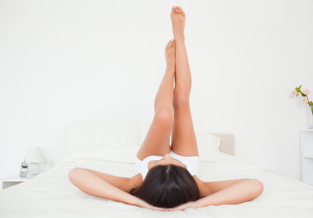 Woman exercising in bed