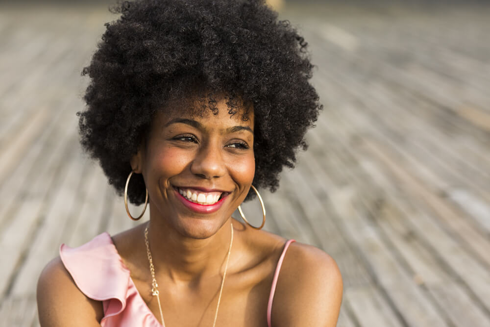 Smiling woman with afro out in the sun