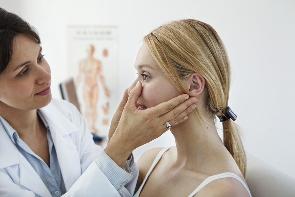 Woman visiting a dermatologist for a check-up.