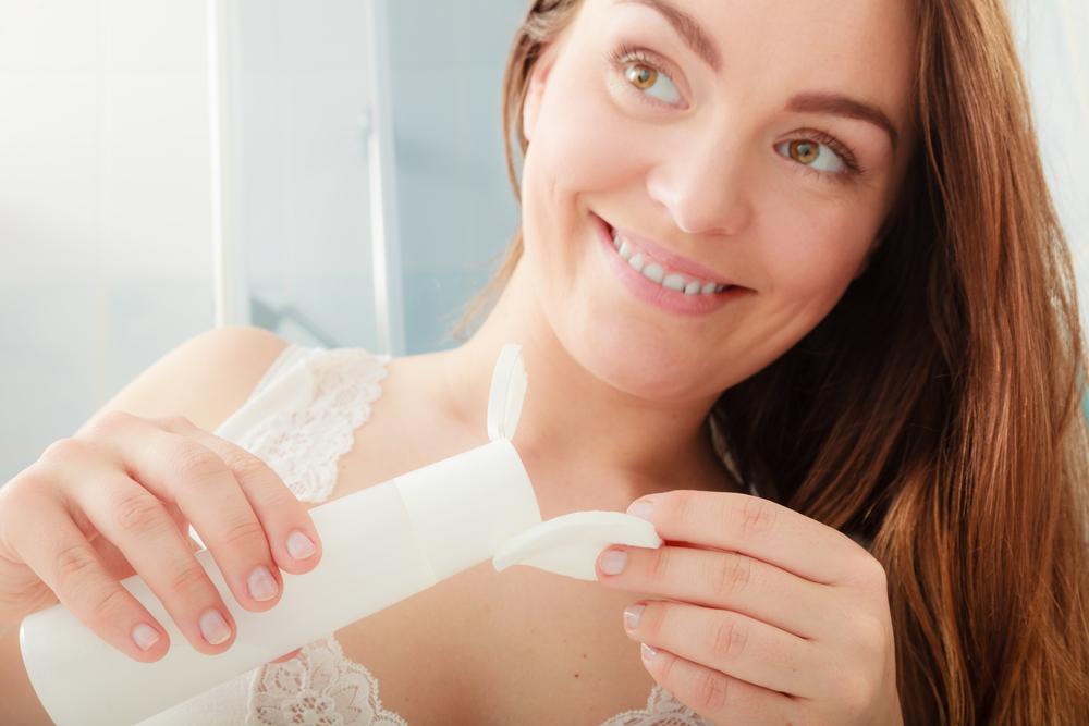 Woman exfoliating her skin